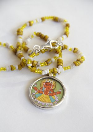 """The White and yellow Ganesh necklace"""